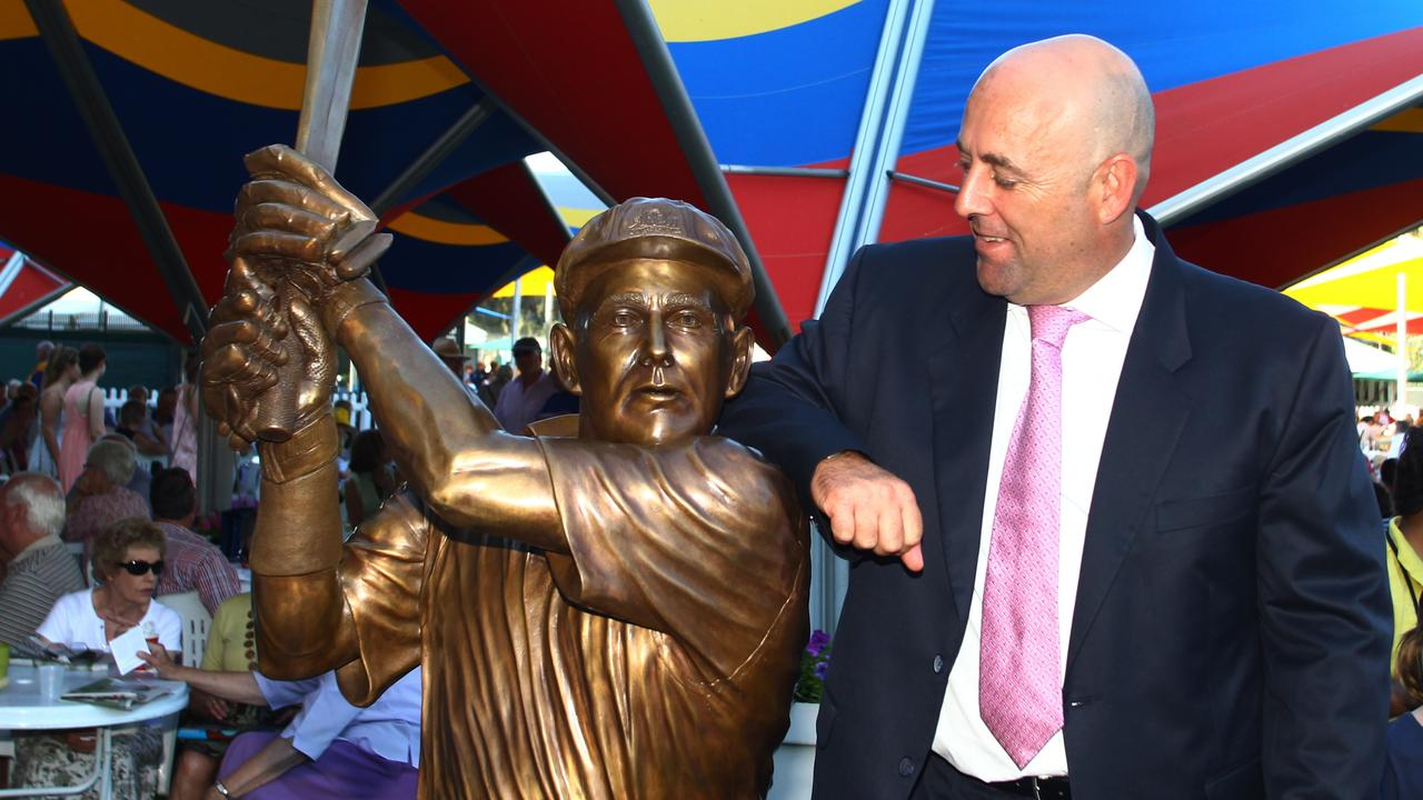Lehmann, posing with his bronze statue, woke with chest pains on his 50th birthday. Picture: Ben Macmahon