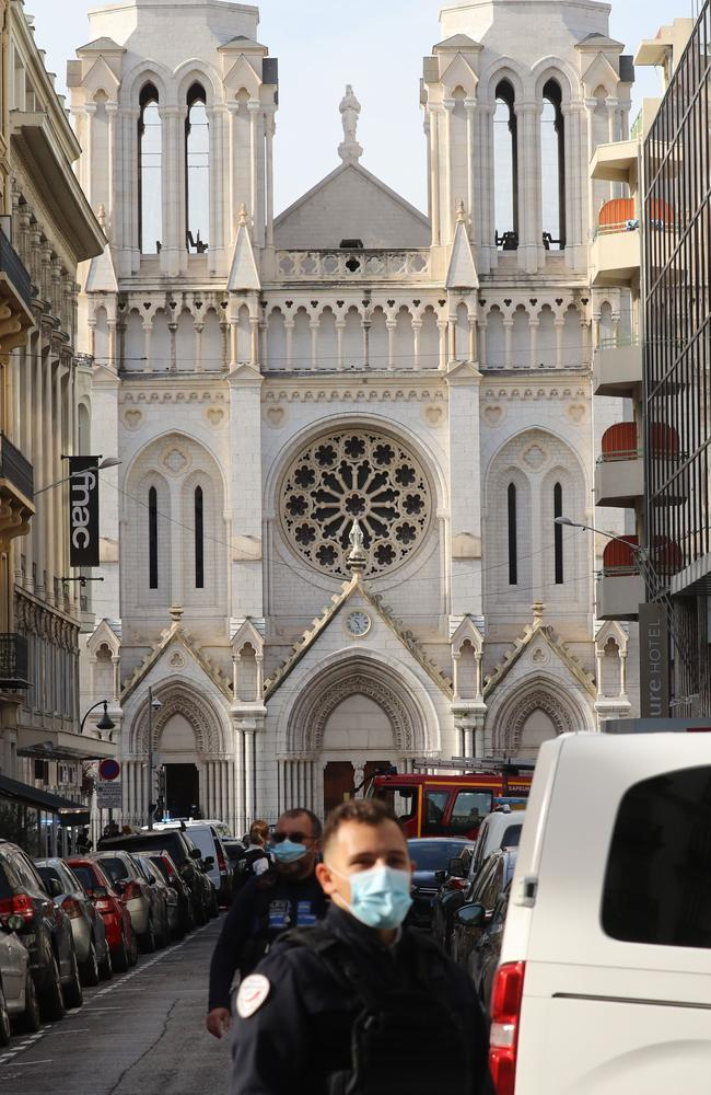 French policemen stand guard a street in front of the Basilica of Notre-Dame de Nice. Picture: Valery Hache/AFP