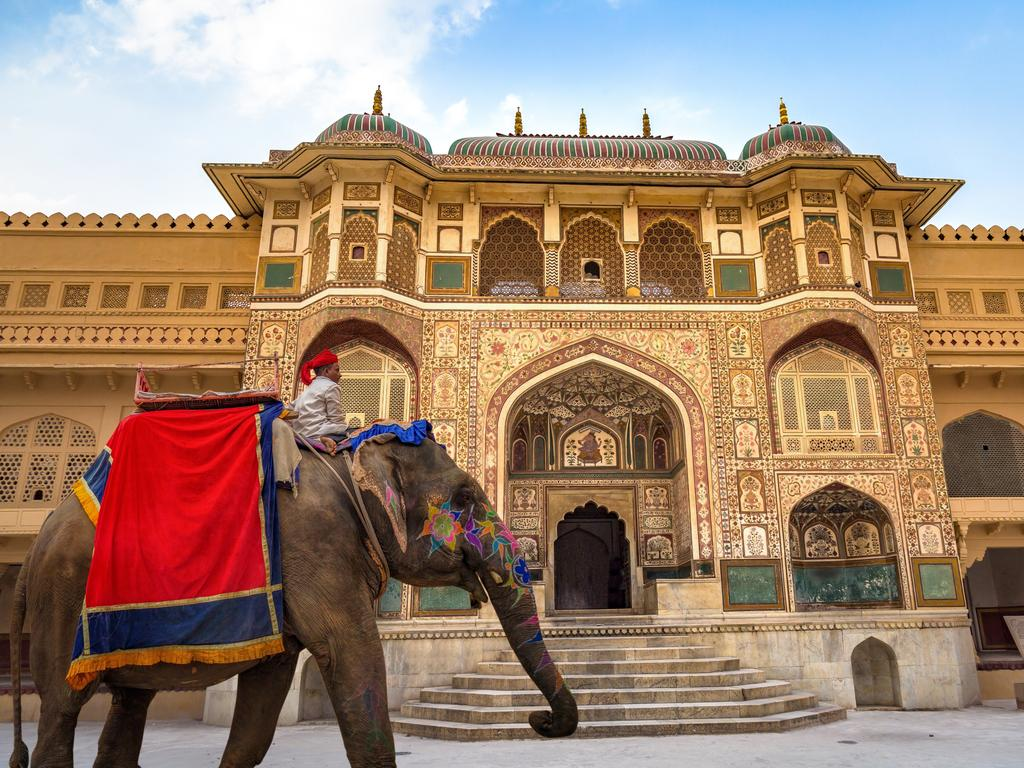 A decorated Indian elephant in front of Amer Fort Palace in Jaipur.