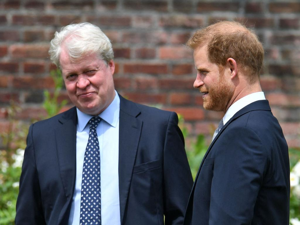 Britain's Prince Harry, Duke of Sussex (R) chats with his uncle Earl Spencer ahead of the unveiling of a statue of their mother, Princess Diana at The Sunken Garden in Kensington Palace.