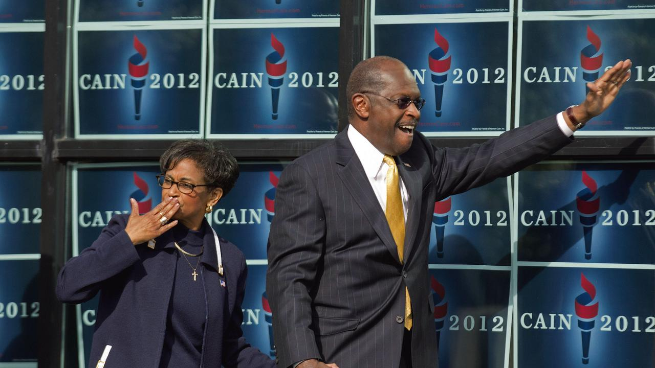 Gloria Cain blows a kiss to the crowd as she arrives with her husband Herman Cain at an event in Atlanta in 2011.