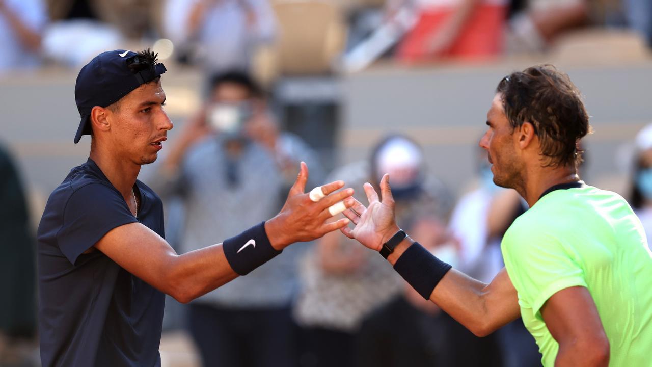 Alexei Popyrin congratulates Rafael Nadal. (Photo by Clive Brunskill/Getty Images)