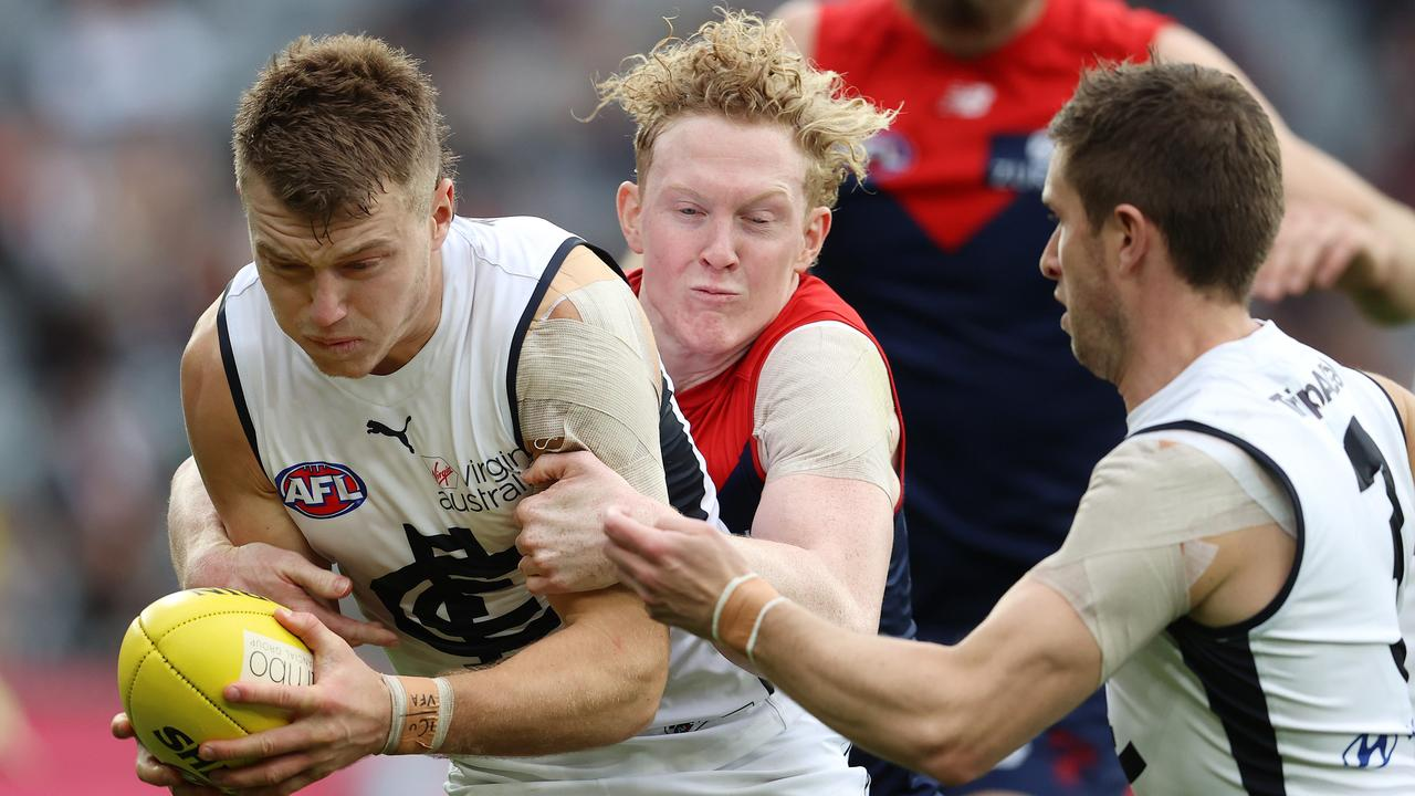 Patrick Cripps is tackled by Clayton Oliver in Melbourne's win over Carlton. Photo: Michael Klein