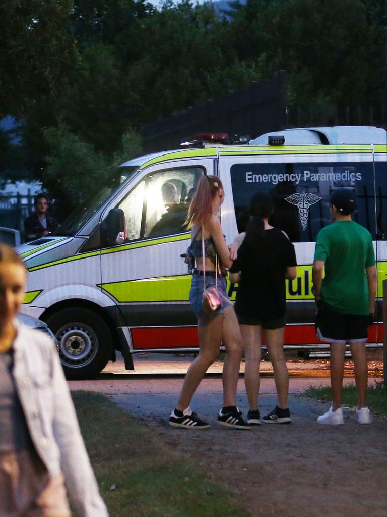 An ambulance leaves the scene of a workplace accident, where a woman fell from an amusement ride at the Cairns Showgrounds, suffering critical injuries. Picture: Brendan Radke