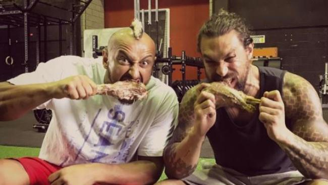 Trainer Mada Abdelhamid and Aquaman star Jason Momoa, still sporting his character's fish-scale tattoos. Picture: Instagram.