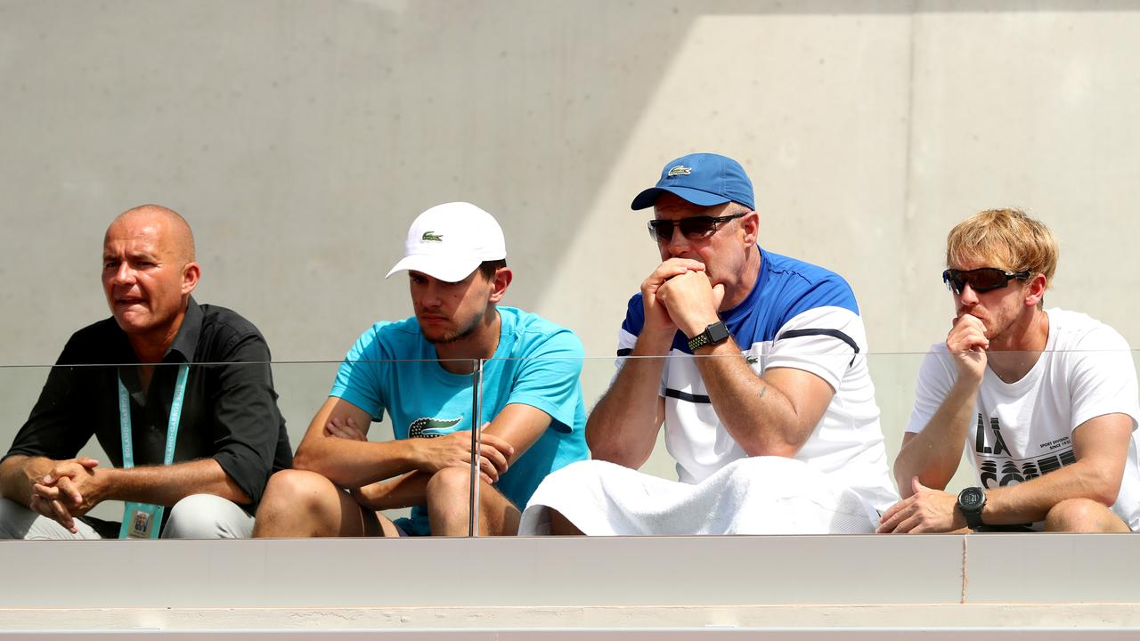 Father of Bernard Tomic, John Tomic, watches on as his son plays in the mens singles first round match against Marco Trungelliti.