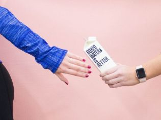 Passing on the wellness baton from one stressed woman to another. Image: Unsplash/Boxed Water