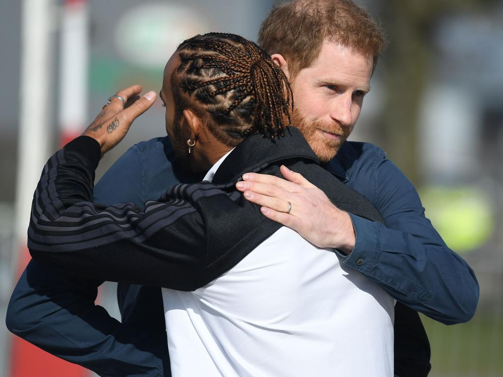 Prince Harry and Lewis Hamilton at Silverstone Racetrack. Picture: AFP
