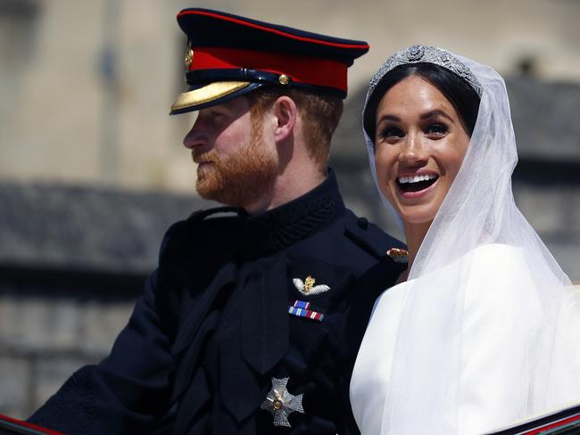 Meghan Markle seemed overjoyed to be in the carriage. Picture: Getty Images