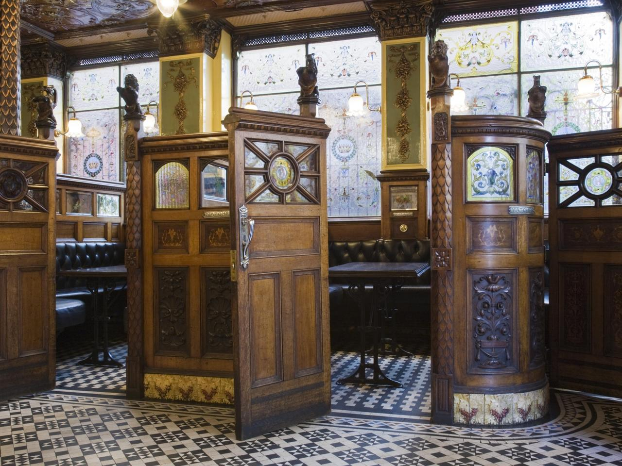 The wooden snugs at The Crown Bar, Great Victoria Street, Belfast. Formerly known as the Crown Liquor Saloon, the pub building dates from 1826 but the wonderful late Victorian craftsmanship of the tiling, glass and woodwork undertaken by Italian workers d
