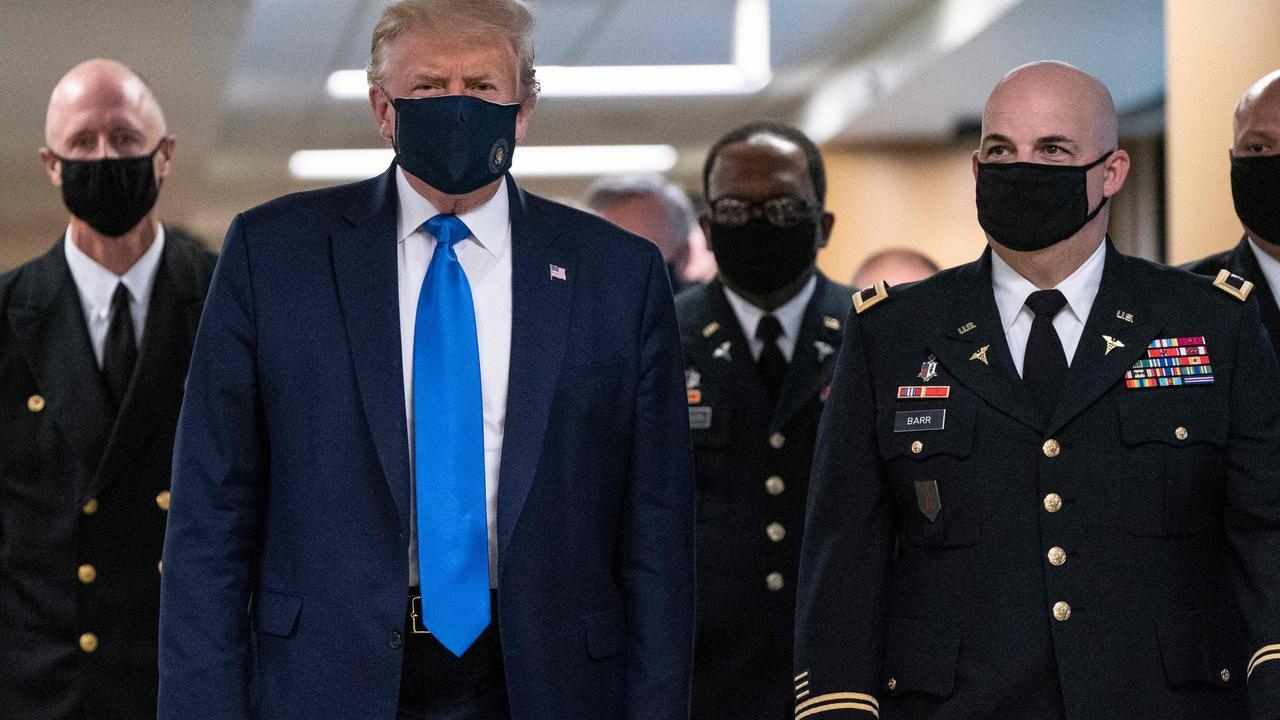 Donald Trump was finally spotted wearing a face mask in public over the weekend. Picture: Alex Edelman/AFP