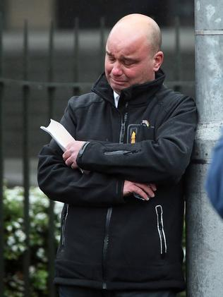 A man cries outside St Patrick's after the service. Picture: Alex Coppel