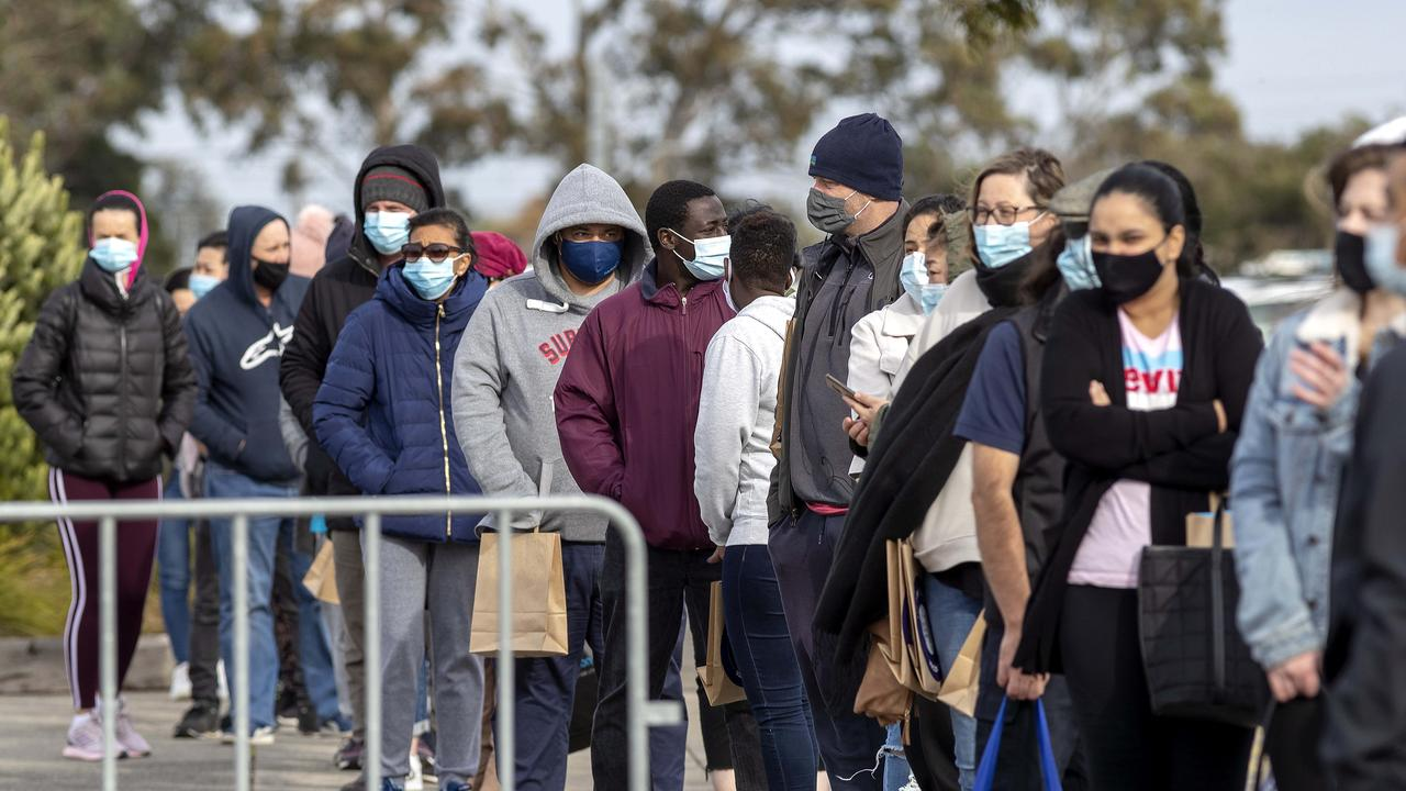 People queue for Covid vaccination at Sandown Racecourse on Saturday. Picture: NCA NewsWire / David Geraghty