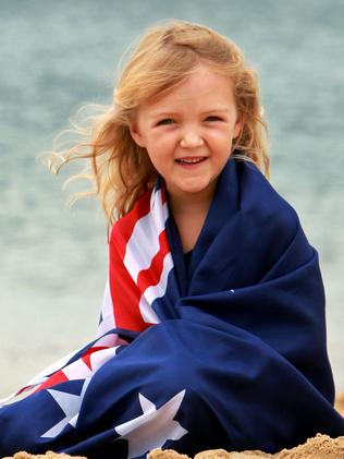 HOLD FOR AUSTRALIA DAY PAGE 1. Daily Telegraph. Australia Day; Asha Olsen, 5 yrs, wrapped in an Australian flag on Horseshoe Beach in Newcastle.