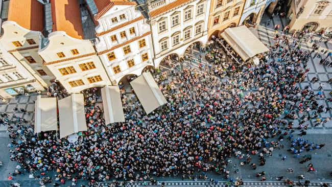 Tourists crowd into the Old Town Square in Prague pre-outbreak. Picture: Getty Images