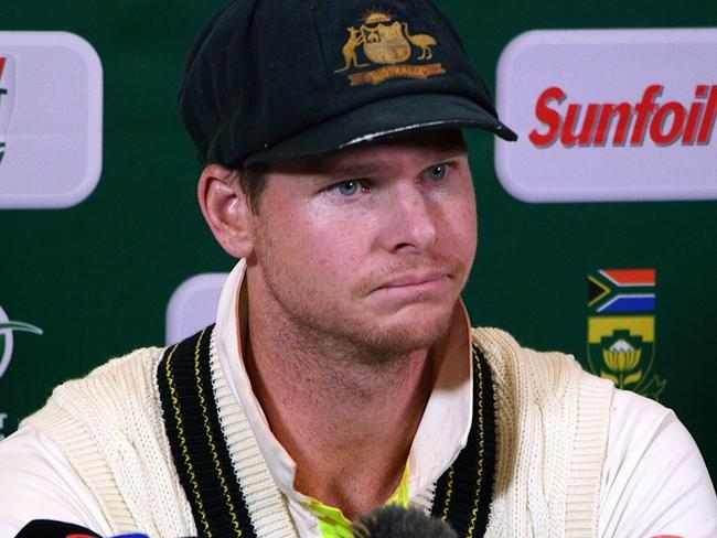 Steve Smith looked despondent when he admitted to ball-tampering during the third Test against South Africa. Picture: AFP