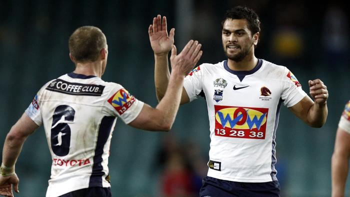 Darren Lockyer (6) and Karmichael Hunt celebrate at full time following Sydney Roosters v Brisbane Broncos NRL qualifying final at SFS in Sydney.