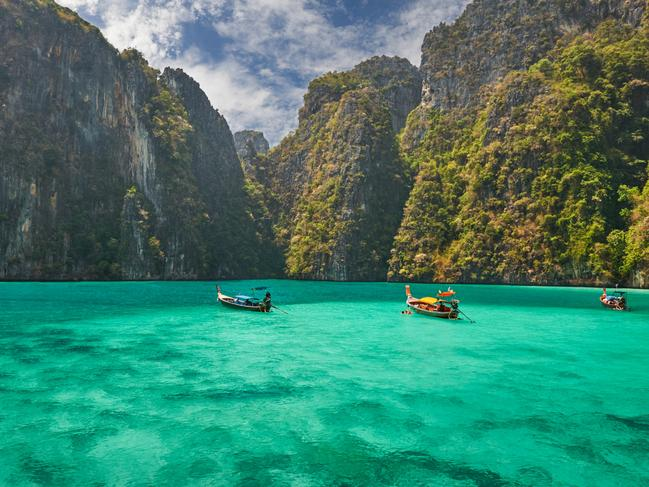 """BEST FOR ISLAND-HOPPING BEACH BUMS: KOH PHI PHI It's easy to escape the crowds of Phuket given the wealth of sparsely populated islands a short boat ride away. And at the top of most visitors Koh hit-lists is Koh Phi Phi. A 45-minute speedboat ride from Phuket, Phi-Phi has been a longtime pit stop on the backpacker Thailand trail since appearing in """"The Beach."""" However, the actual beach used in the blockbuster movie (Maya Bay on Phi Phi Leh) became a victim of its own success and was closed in 2018 by the Thai government in an attempt to allow its ecology to recover. Set to remain off-limits until at least next year, tourists can still visit Leh and the other five islands (each endowed with a string of blissful beaches) that comprise the mini-archipelago."""