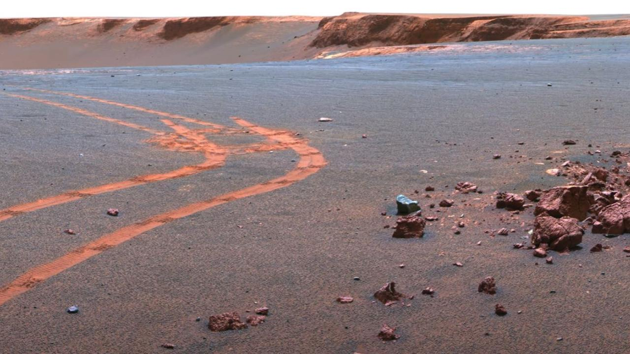 The stunning pictures show the surface of Mars. Picture: YouTube/ElderFox Documentaries
