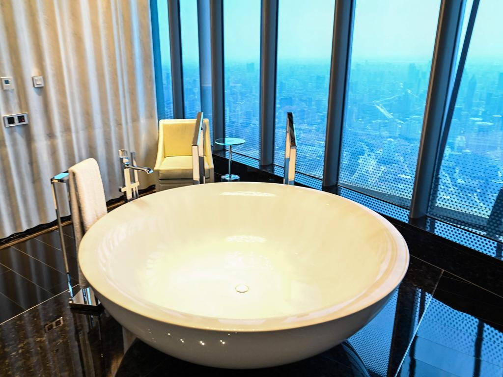 View of a bathroom in a suite room of the J Hotel, the world's highest luxury hotel, boasting a restaurant on the 120th floor and 24-hour personal butler service, located in the Shanghai Tower, in Shanghai on June 23, 2021. (Photo by Hector RETAMAL / AFP)