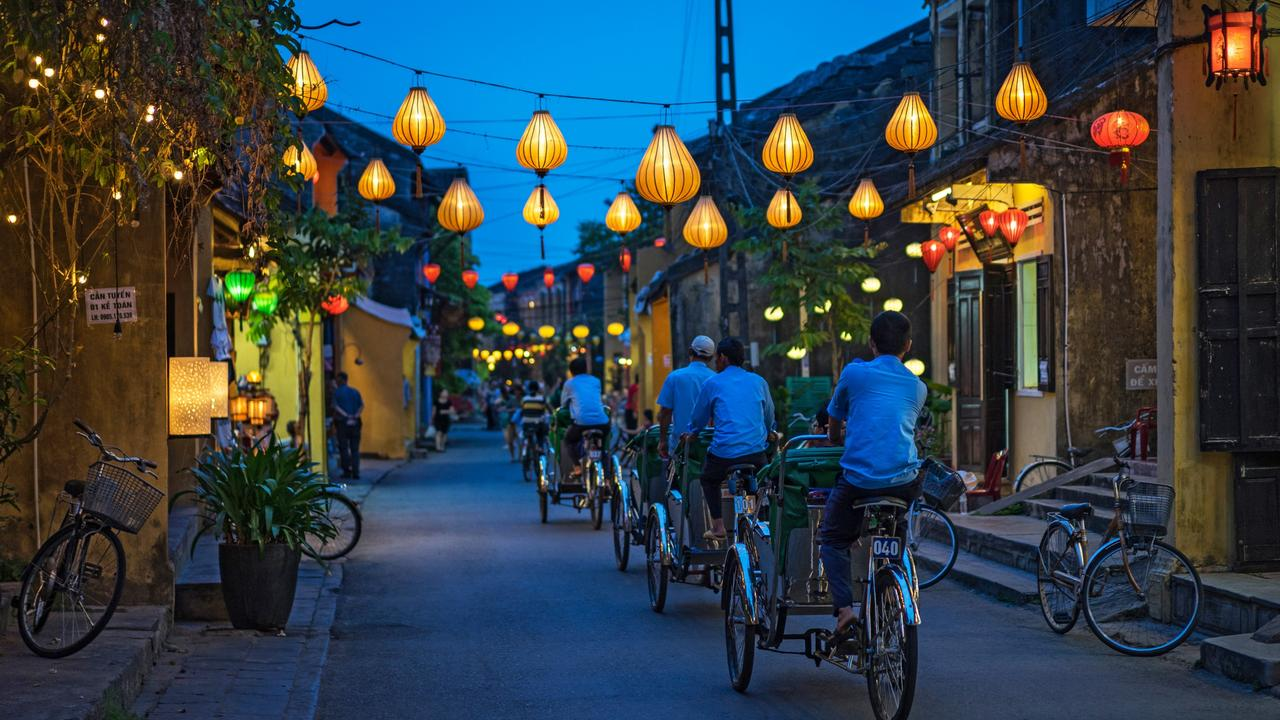 Night view of busy street in Hoi An, Vietnam.