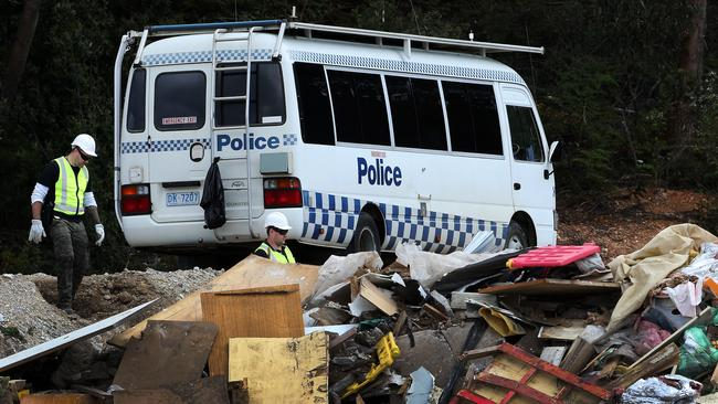 Police look for evidence, relating to the disappearance of a local man, at the Ulverstone tip. Pictures: CHRIS KIDD