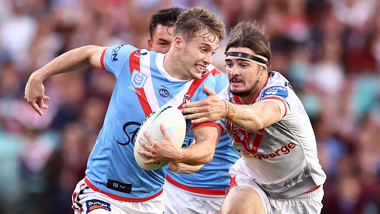 Sam Walker of the Roosters is tackled.