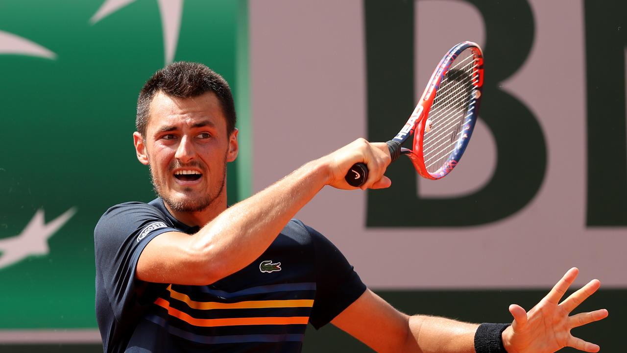 Bernard Tomic of Australia plays a forehand during the mens singles first round match against Marco Trungelliti.
