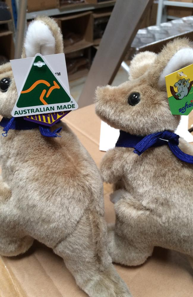 Identical marsupials: 'Australian Made' kangaroo (left) and its twin (right) still with the Chinese tag on its ear. Picture: GJ