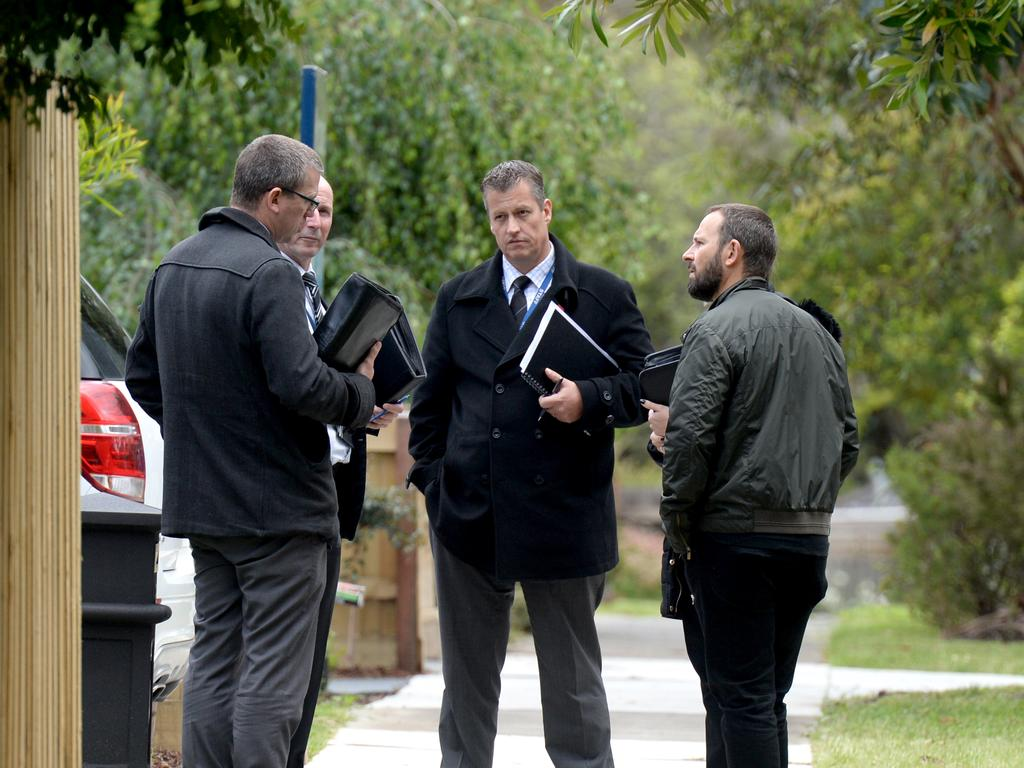 Police doorknock and speak to residents of Larissa Court, Croydon, after Saturday's murder on EastLink. Picture: Andrew Henshaw