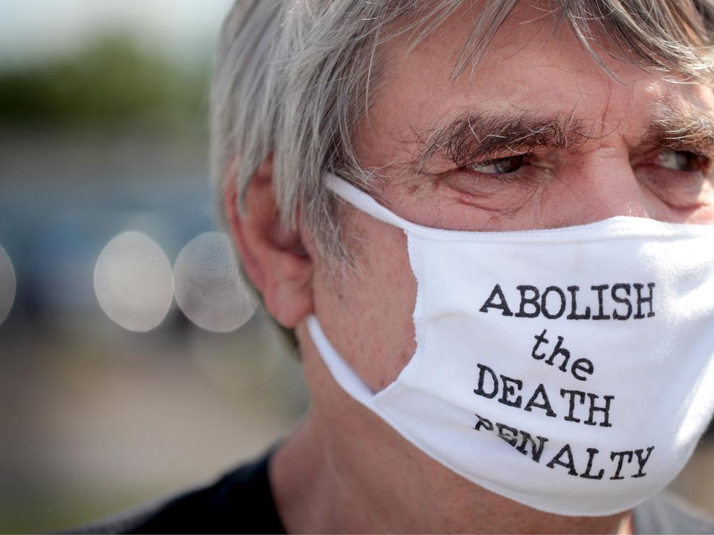 Protesters, including Bill Pelke of Anchorage, Alaska, gathered outside the prison in Indiana as Lee was executed. Picture: Scott Olson/Getty Images/AFP