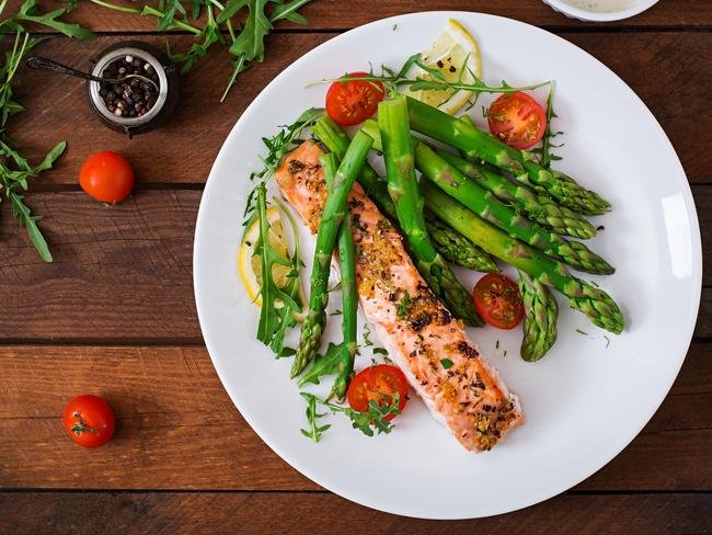 Sit down and slowly enjoy your baked salmon. You'll be far less likely to eat mindlessly.