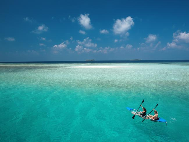 """CRUISE CRYSTAL CLEAR SEAS IN A CLEAR CANOE If being in a private villa on a remote island still doesn't have enough """"getting away from it all"""" factor, then try jumping in a two-man canoe for an ocean adventure together. But not just any canoe - one that's entirely transparent. At luxe property, Baros, clear Molokini canoes offer unobstructed views of fish and black-tip sharks."""