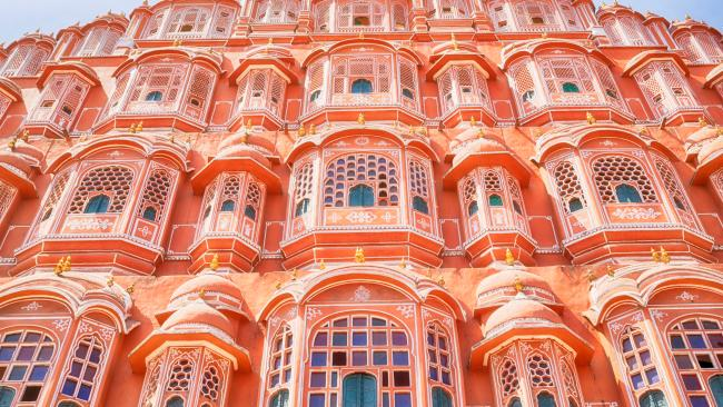 Hawa Mahal / Palace of the Winds - Jaipur, India The Palace of the Wind gorgeously glows in red and pink sandstone.