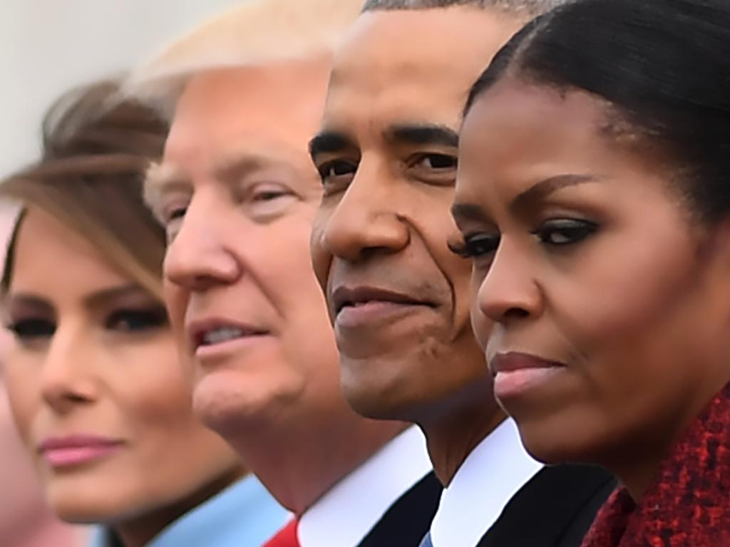 """(FILES) L-R: First Lady Melania Trump, President Donald Trump,former President Barack Obama, Michelle Obama at the US Capitol after inauguration ceremonies at the in Washington, DC, on January 20, 2017. While the new US president has shown a capacity to change, both his tone and his positions, he has been unable to show the world a """"new"""" Trump, with a steady presidential style and a clearly articulated worldview. As the symbolic milestone of his 100th day in power, which falls on April 29, 2017, draws near, a cold, hard reality is setting in for the billionaire businessman who promised Americans he would """"win, win, win"""" for them. At this stage of his presidency, he is the least popular US leader in modern history (even if his core supporters are still totally behind him.) / AFP PHOTO / JIM WATSON / TO GO WITH AFP STORY, US-politics-Trump-100days"""