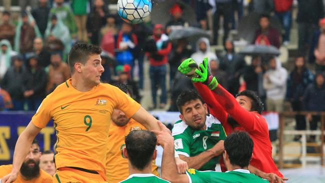 Tomi Juric goes up for the ball against Iran. Pic Mark Evans