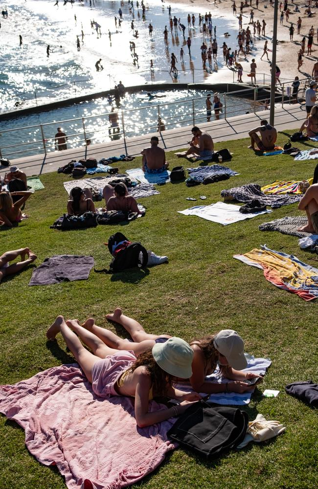 """Scenes of Bondi Beach on TV (above, pictured last weekend) are angering people in Bankstown, one of whom said they were caged in """"a zoo"""". Picture: NCA NewsWire/ Flavio Brancaleone"""