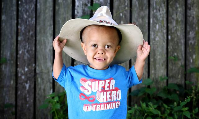 4yo Murri boy Quaden Bayles has dwarfism and spends most of his life in hospital. Quaden was named after 'cowboy Quaden' and wears his Uncle Jimmy Bales cowboy Hat.  Photograph; Renae Droop