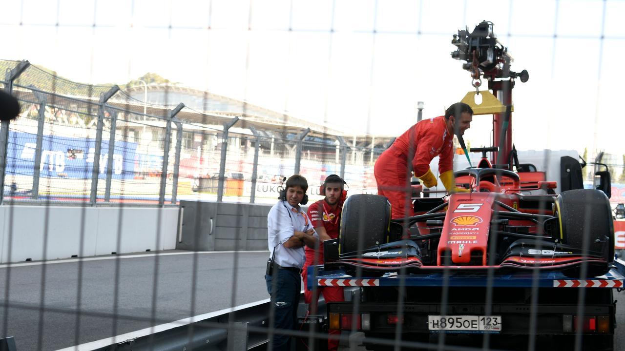 A track marshal loads Sebastian Vettel's car on a truck. Picture: Dimitar Dilkoff