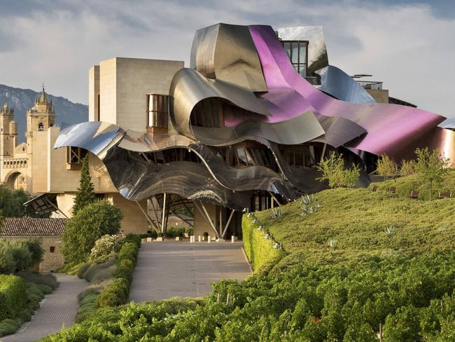 HOTEL MARQUES DE RISCAL, ALAVA, SPAIN Wine-lover and architectural fan? The Hotel Marques de Riscal in Spain's Basque Country is the hotel for you. A fusion of award-winning winery and avant-garde architecture, this 150-year-old Rioja wine estate has been transformed by architect superstar Frank Gehry (best known for the Guggenheim in Bilbao) into a fantastical five-star property housing a spa, museum and wine shop, alongside 43 flamboyantly decorated rooms across two separate wings connected via a footbridge. The swirling, multi-coloured ribbon-like facade is designed to reflect the colours of the grapes, the wine, and the signature gold mesh applied to the winery's bottles.