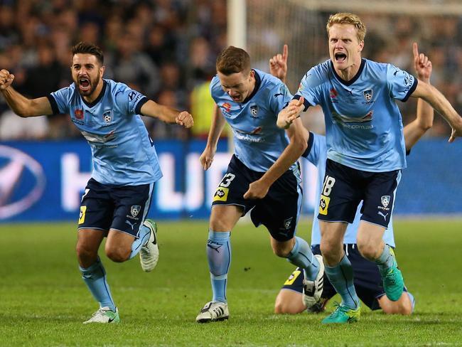 Sydney celebrate their grand final win.