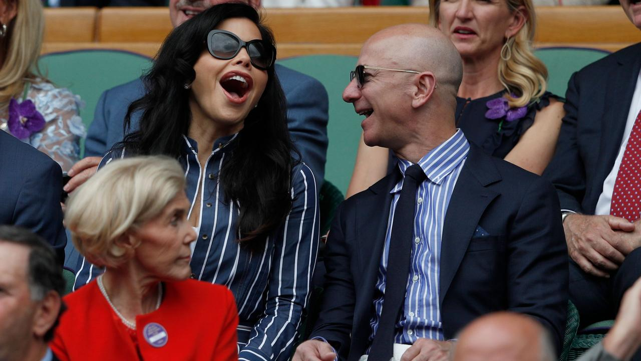 Jeff Bezos (right) and Lauren Sanchez at the 2019 Wimbledon Championships in London. Picture: Adrian Dennis/AFP