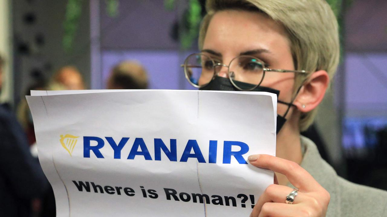A woman stands with a poster reading 'Where is Roman (Protasevich)?!' in Athens after a plane was diverted by Belarus with the activist on board. Picture: Petras Malukas/AFP
