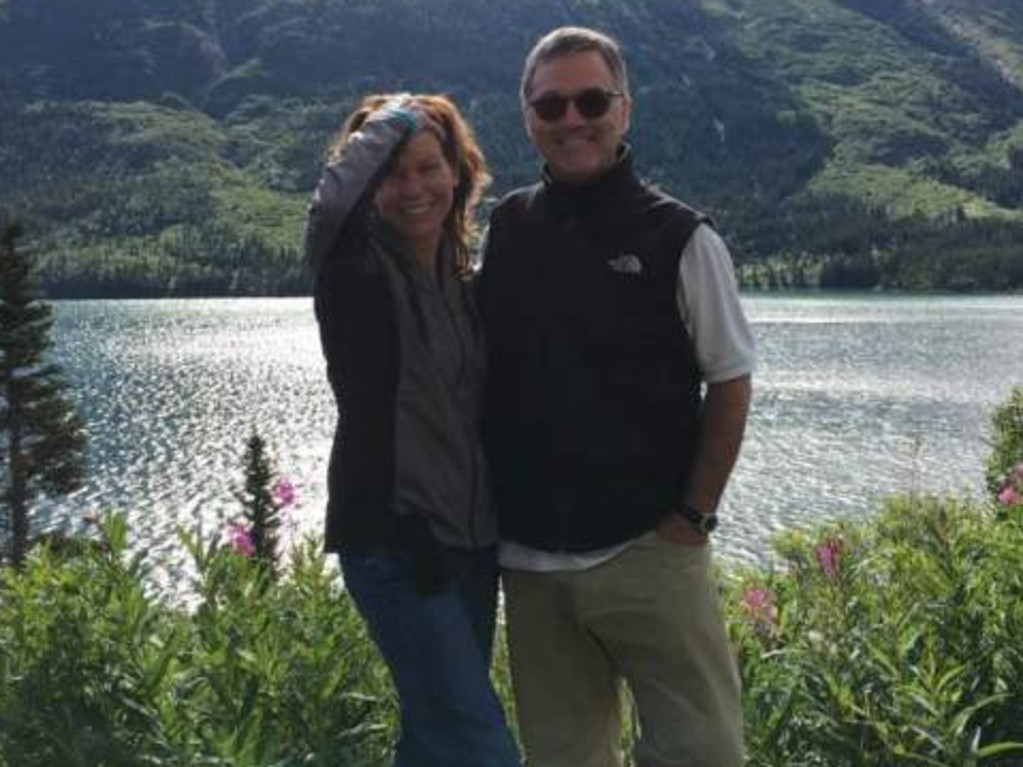 Mr Bishop with his girlfriend of one year, clinical psychologist Julie Seel, who seized control of his estate after his son was charged with murder. Picture: Facebook