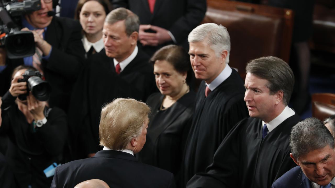 President Donald Trump shakes hands with Supreme Court Justice Brett Kavanaugh. Picture: AP
