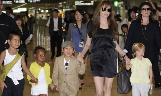 (FILES) This file photo taken on July 26, 2010 shows US actress Angelina Jolie (2R), accompanied by her children Maddox (L), Zahara (2L), Pax (3L) and Shiloh (R), arriving at the Narita International Airport. Brad Pitt is under investigation by US authorities after being accused of physically and verbally abusing his children during an angry outburst, TMZ reported September 22, 2016. According to the entertainment news site the Los Angeles Police Department began probing Pitt based on an anonymous tip received by the LA County Department of Children and Family Services, as is systematic following any report of child abuse. / AFP PHOTO / Yoshikazu TSUNO