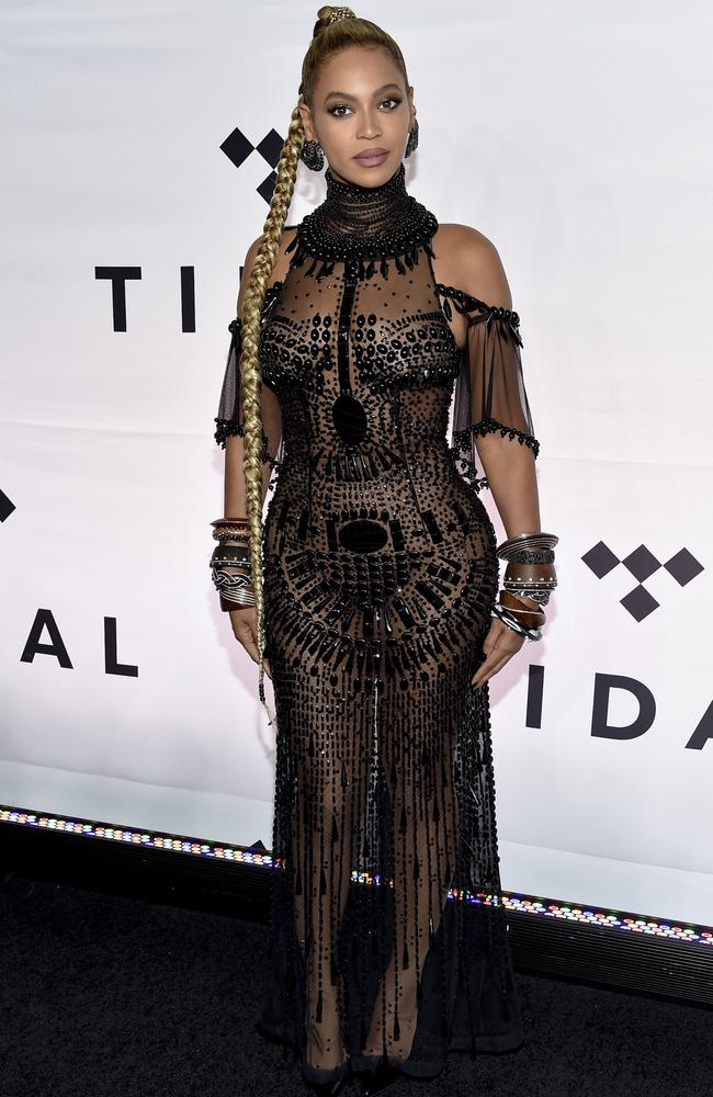 The singer earlier walked the red carpet in this see through frock. Picture: Evan Agostini/Invision/AP)