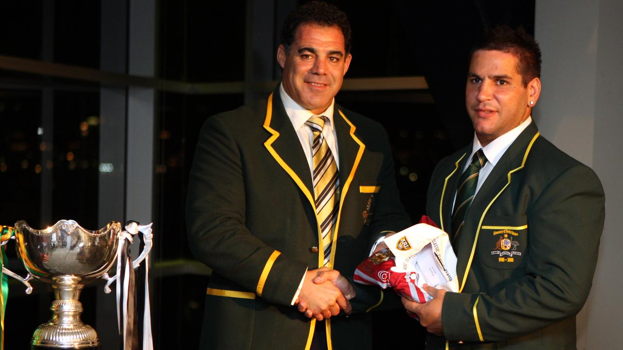 Mal Meninga presents Carl Webb with his first Australian jersey in 2008. Picture: Gregg Porteous.