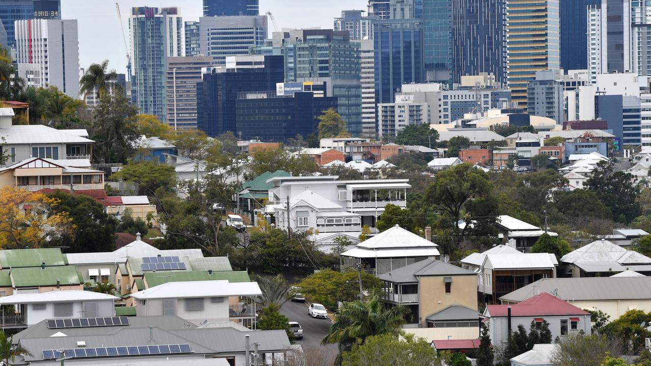 Houses and apartment buildings are seen in the Brisbane suburbs of Paddington and Petrie Terrace. Image: AAP/Darren England.