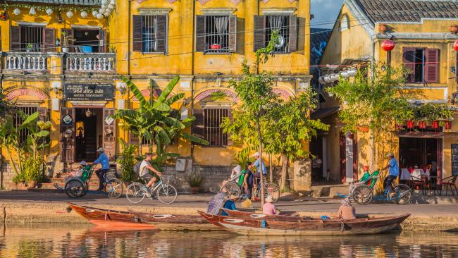 Hoi An, Vietnam Take a stroll along the river that is the main artery of the ancient town of Hoi An. By night, it is lit up with hundreds of glowing lanterns and becomes a buzzing spot for locals and tourists.
